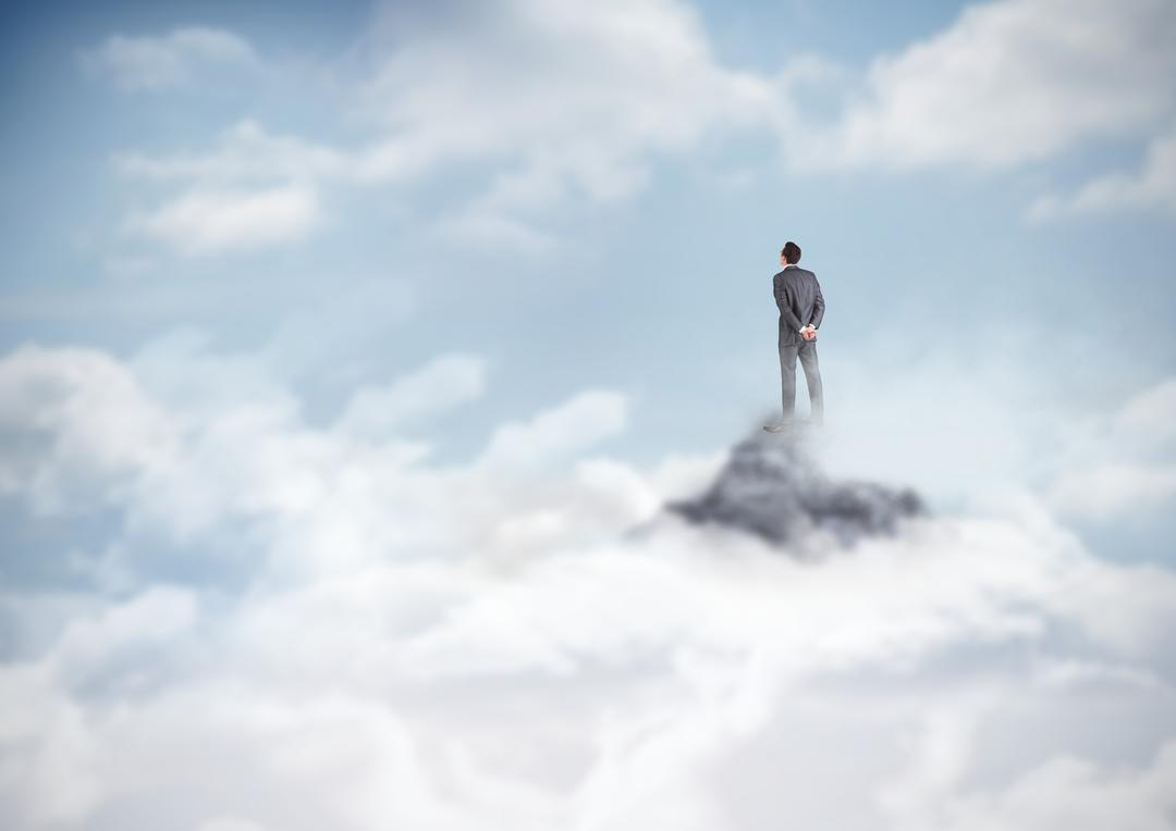 Digital composite of Business man standing on mountain peak in the clouds
