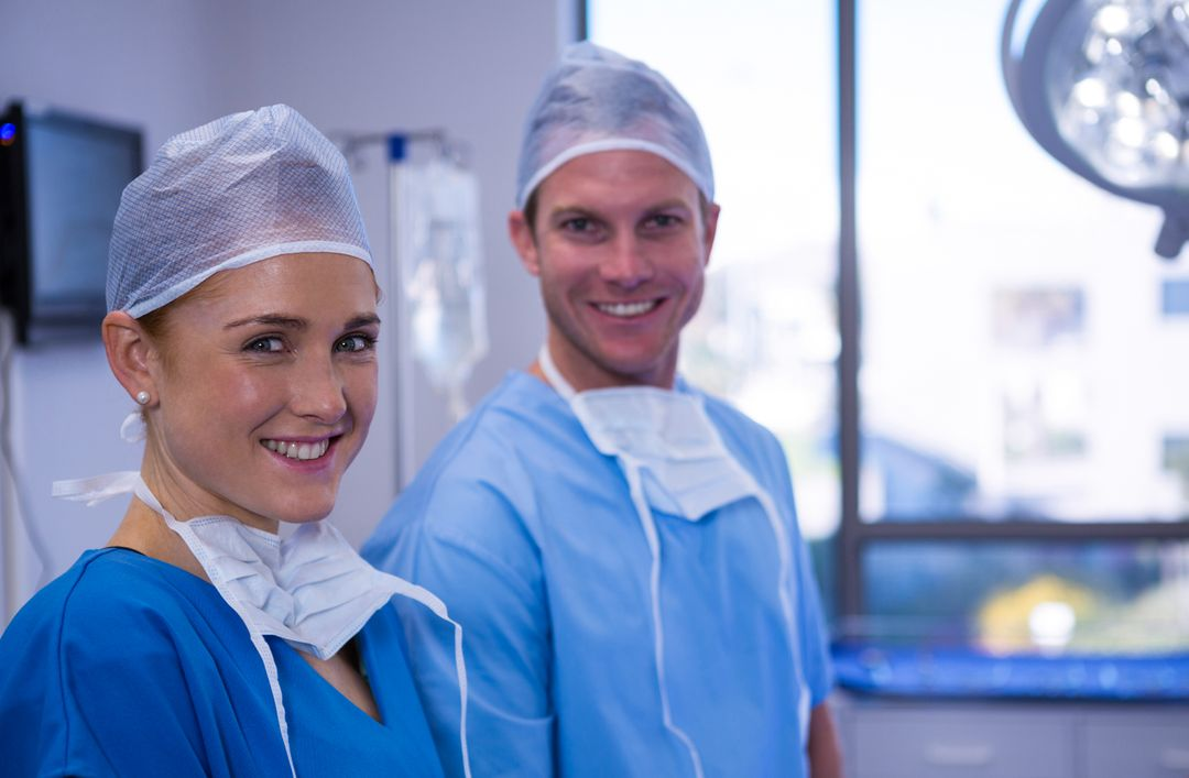 Portrait of male and female nurse smiling in operation theater at hospital Free Stock Images from PikWizard