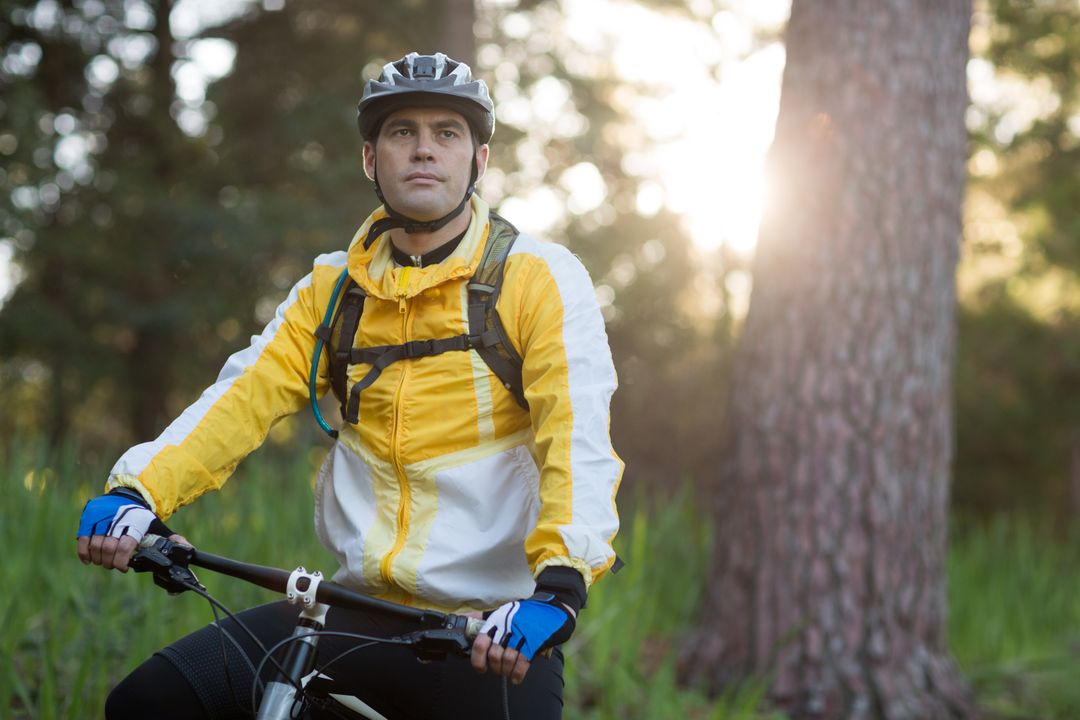 Male biker with mountain bike in countryside forest Free Stock Images from PikWizard