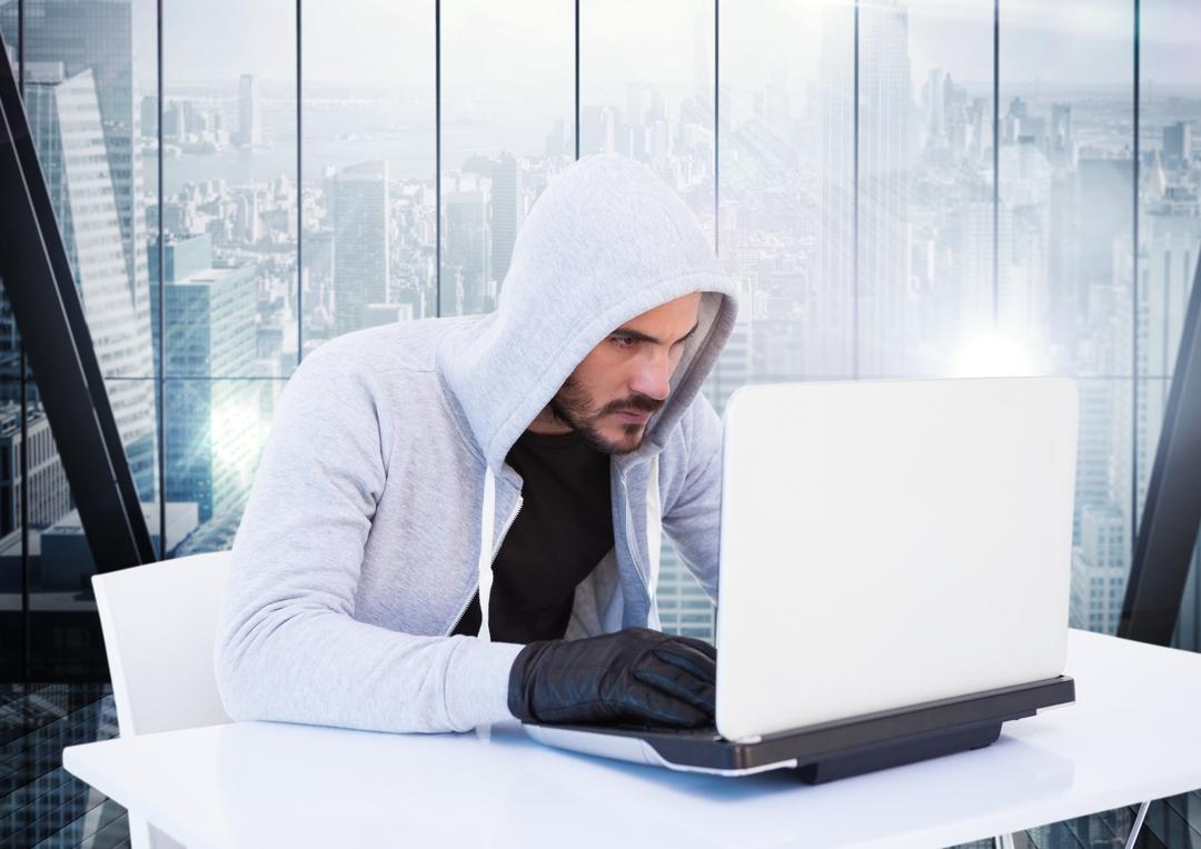 Digital composite of Criminal in hood with laptop in front of window Free Stock Images from PikWizard