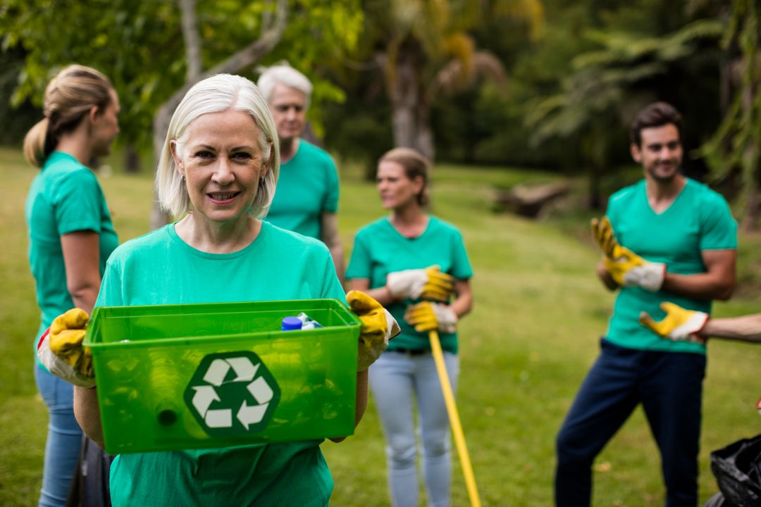 Portrait of recycling team member standing in park Free Stock Images from PikWizard