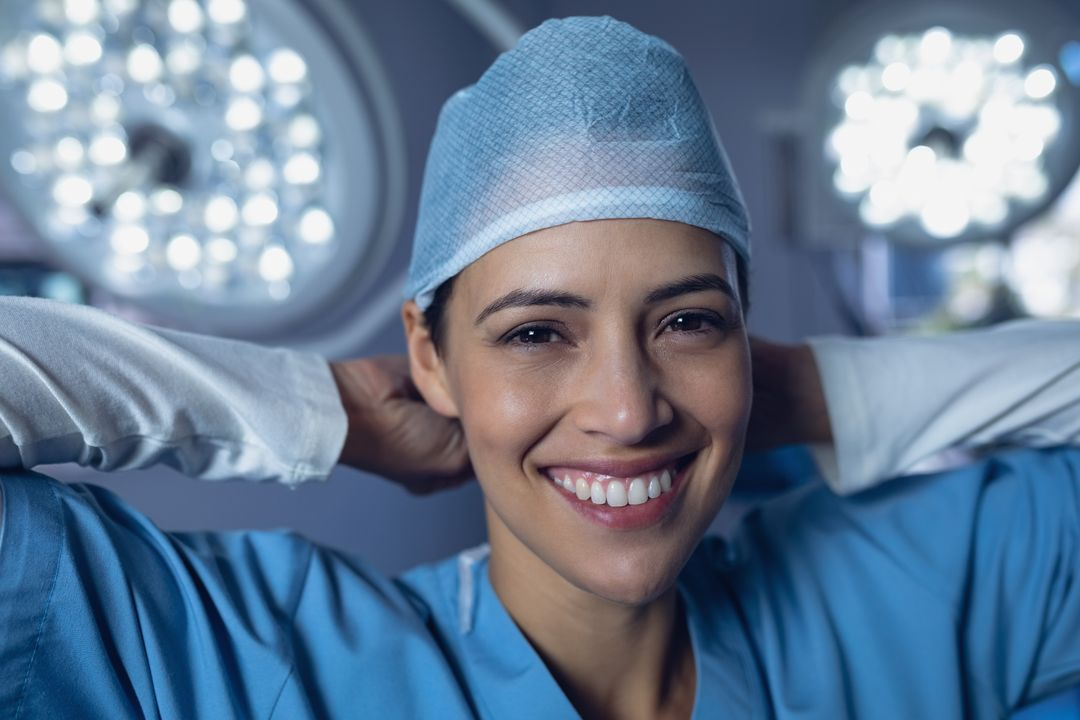 Portrait of female surgeon wearing surgical cap in operation room at hospital