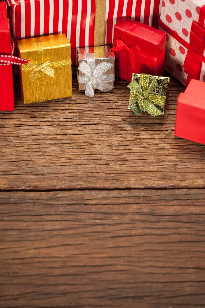 Various wrapped gift box on wooden table during christmas time