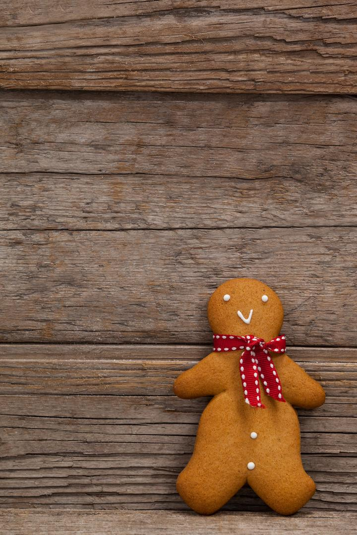 Close-up of gingerbread leaning on a plank