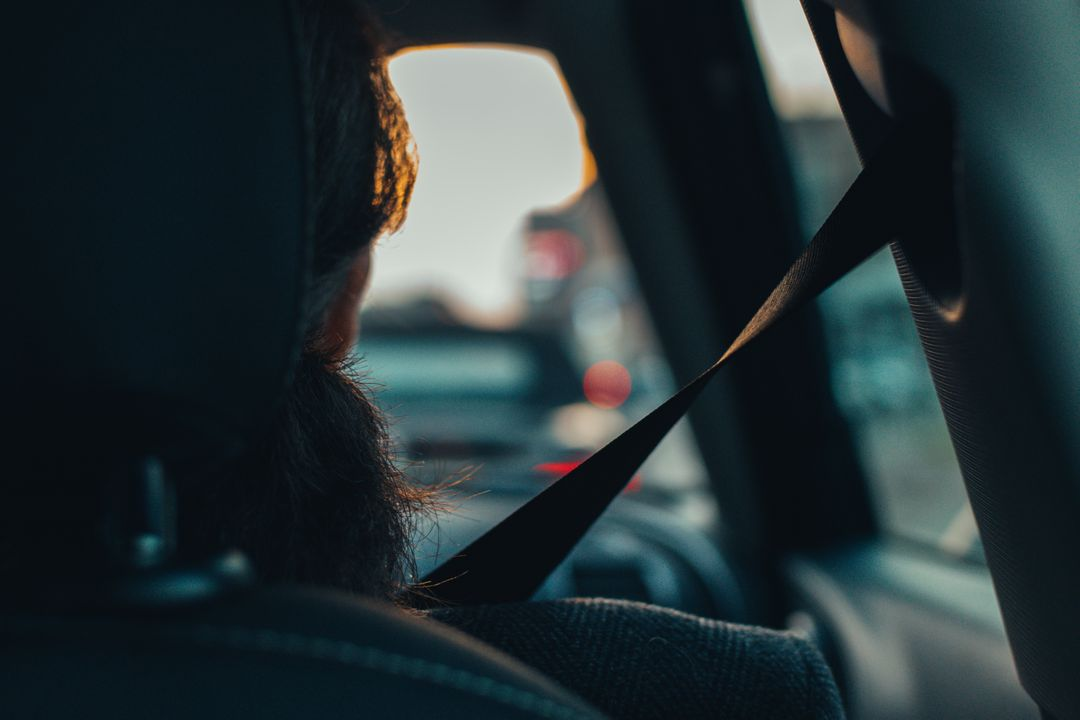 Woman Looking at Camera Seen Through Car Windshield