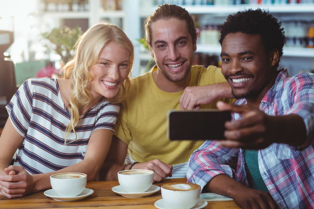 Three friends taking a selfie in cafe Free Stock Images from PikWizard