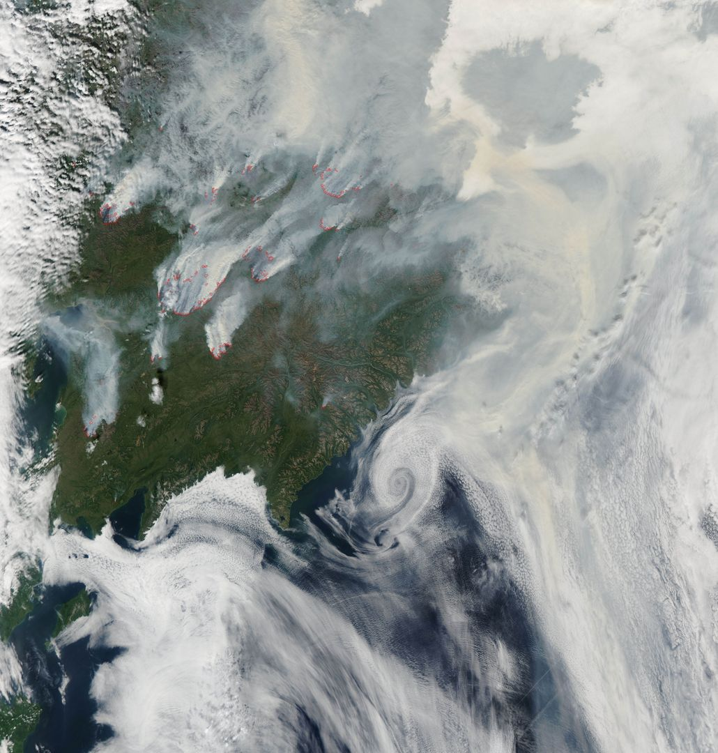 "NASA image acquired August 1, 2010  Intense fires continued to burn in the boreal forests of eastern Siberia on August 1, 2010. The fires are outlined in red in this image, acquired by the Moderate Resolution Imaging Spectroradiometer (MODIS) on NASA's Aqua satellite. The fires span the borders of Russia's Chukotskiy, Magadan, and Koryakskiy provinces.      Burning in coniferous (evergreen) forests, the fires blanketed northeastern Siberia with thick brown smoke. The smoke hugs the ground near the fires, filling valleys, and soars over clouds farther away from the flames. On August 1, the smoke flowed north from the fires and over the Arctic Ocean. A wide view of the Arctic shows the smoke crossing the Bering Strait and clouding skies over northern Alaska.  This image is available in additional resolutions from the MODIS Rapid Response Team here: <a href=""http://rapidfire.sci.gsfc.nasa.gov/gallery/?2010213-0801/Russia.A2010213.0045.2km.jpg"" rel=""nofollow"">rapidfire.sci.gsfc.nasa.gov/gallery/?2010213-0801/Russia....</a>  To view more images from this event go to: <a href=""http://earthobservatory.nasa.gov/NaturalHazards/event.php?id=44561"" rel=""nofollow"">earthobservatory.nasa.gov/NaturalHazards/event.php?id=44561</a>  NASA image courtesy Jeff Schmaltz, MODIS Rapid Response Team at NASA GSFC.   Caption by Holli Riebeek  Instrument: Aqua - MODIS  <b><a href=""http://www.nasa.gov/centers/goddard/home/index.html"" rel=""nofollow"">NASA Goddard Space Flight Center</a></b>  is home to the nation's largest organization of combined scientists, engineers and technologists that build spacecraft, instruments and new technology to study the Earth, the sun, our solar system, and the universe.  <b>Follow us on <a href=""http://twitter.com/NASA_GoddardPix"" rel=""nofollow"">Twitter</a></b>  <b>Join us on <a href=""http://www.facebook.com/pages/Greenbelt-MD/NASA-Goddard/395013845897?ref=tsd"" rel=""nofollow"">Facebook</a><b></b></b>"