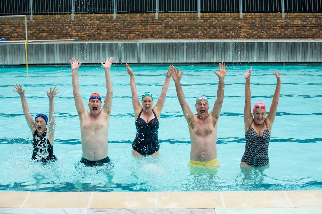 Portrait of carefree senior swimmers enjoying in pool Free Stock Images from PikWizard
