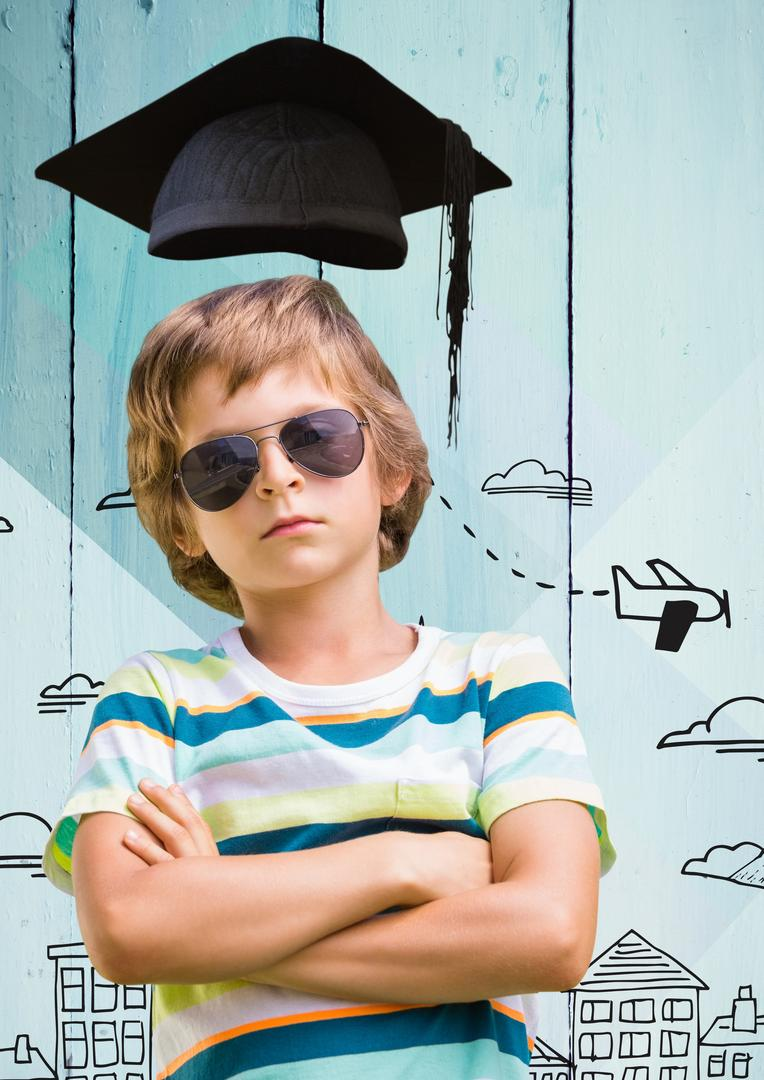 Digital composition of boy in sunglasses and mortarboard standing with arms crossed