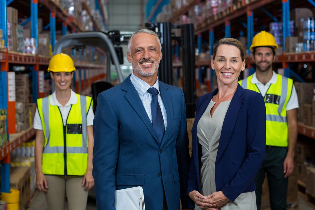 Portrait of warehouse manager standing with client in warehouse Free Stock Images from PikWizard