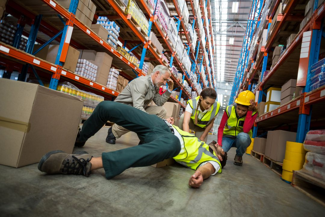 Worker fallen down while carrying cardboard boxes in warehouse Free Stock Images from PikWizard