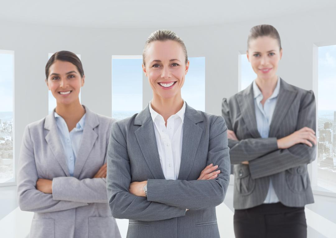 Digital composite image of female executives standing with arms crossed in office Free Stock Images from PikWizard