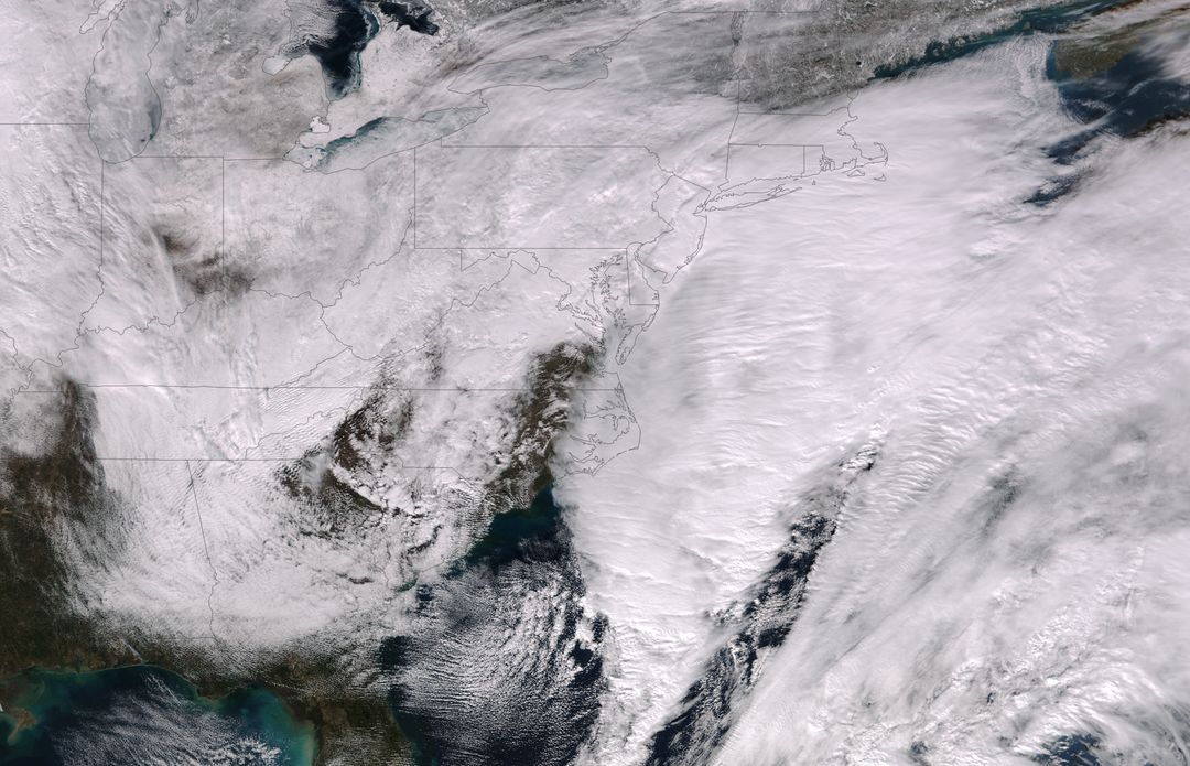 "This image was taken by the Suomi NPP satellite's VIIRS instrument at 1825Z on January 26, 2015.  A low pressure system currently forming off the mid-Atlantic coast will rapidly strengthen into a major nor'easter today and affect parts of the Northeast U.S. through early Wednesday. This system will be responsible for heavy to intense snowfall and strong winds, with blizzard conditions expected from eastern New Jersey to eastern Massachusetts where Blizzard Warnings are in effect.   Accumulations will likely exceed one foot from eastern New Jersey through eastern Maine by late Tuesday.   The heaviest snow accumulations, perhaps exceeding two feet, are forecast across portions of Connecticut, Rhode Island and Massachusetts, including the Boston area. Currently, New York City is forecast to receive 18-24 inches of snow, and Boston is forecast to receive 24-36 inches of snow. Wind gusts of 45 to 60 mph will be common from eastern New Jersey to eastern Massachusetts, leading to widespread blizzard conditions. Wind gusts up to 70 mph are possible in far eastern Massachusetts, including Cape Cod and Nantucket.   Credit: NASA/NOAA/NPP/VIIRS  Via: NASA/NOAA via <b><a href=""www.nnvl.noaa.gov/"" rel=""nofollow""> NOAA Environmental Visualization Laboratory</a></b>  <b><a href=""http://www.nasa.gov/audience/formedia/features/MP_Photo_Guidelines.html"" rel=""nofollow"">NASA image use policy.</a></b>  <b><a href=""http://www.nasa.gov/centers/goddard/home/index.html"" rel=""nofollow"">NASA Goddard Space Flight Center</a></b> enables NASA's mission through four scientific endeavors: Earth Science, Heliophysics, Solar System Exploration, and Astrophysics. Goddard plays a leading role in NASA's accomplishments by contributing compelling scientific knowledge to advance the Agency's mission. <b>Follow us on <a href=""http://twitter.com/NASAGoddardPix"" rel=""nofollow"">Twitter</a></b> <b>Like us on <a href=""http://www.facebook.com/pages/Greenbelt-MD/NASA-Goddard/395013845897?ref=tsd"" rel=""nofollow"">Facebook</a></b> <b>Find us on <a href=""http://instagram.com/nasagoddard?vm=grid"" rel=""nofollow"">Instagram</a></b>"