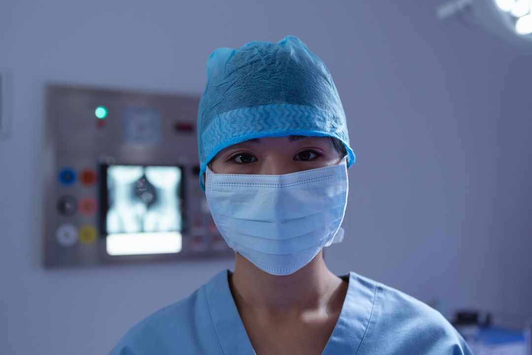 Front view of female surgeon with surgical mask looking at camera in operation room at hospital Free Stock Images from PikWizard