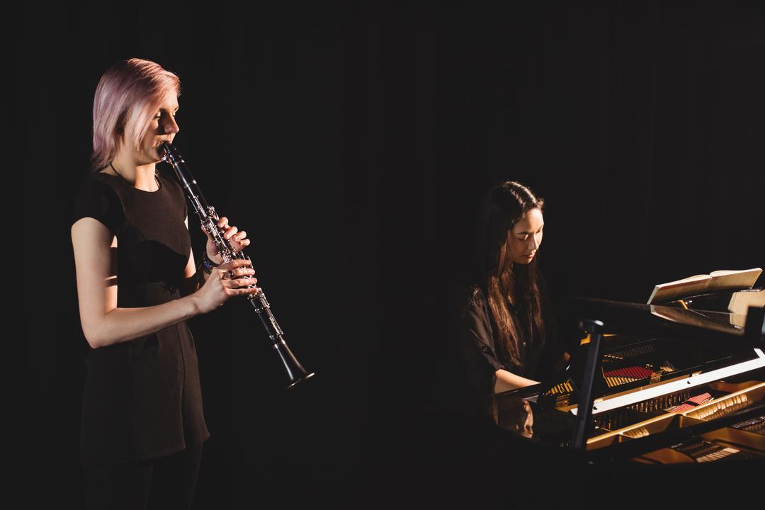Students playing clarinet and piano at music school