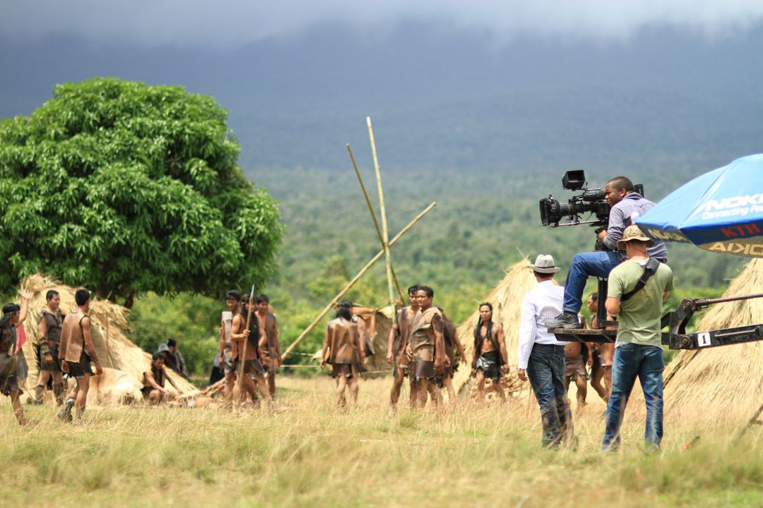 Film crew working shooting a scene in rural location