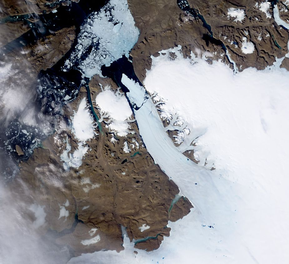 "NASA image acquired August 5, 2010  On August 5, 2010, an enormous chunk of ice, roughly 97 square miles (251 square kilometers) in size, broke off the Petermann Glacier, along the northwestern coast of Greenland. The Canadian Ice Service detected the remote event within hours in near real-time data from the Moderate Resolution Imaging Spectroradiometer (MODIS) on NASA's Aqua satellite. The Peterman Glacier lost about one-quarter of its 70-kilometer (40-mile) long floating ice shelf, said researchers who analyzed the satellite data at the University of Delaware.  The Moderate Resolution Imaging Spectroradiometer (MODIS) on NASA's Terra satellite captured these natural-color images of Petermann Glacier 18:05 UTC on August 5, 2010 (top), and 17:15 UTC on July 28, 2010 (bottom). The Terra image of the Petermann Glacier on August 5 was acquired almost 10 hours after the Aqua observation that first recorded the event. By the time Terra took this image, skies were less cloudy than they had been earlier in the day, and the oblong iceberg had broken free of the glacier and moved a short distance down the fjord.  Icebergs calving off the Petermann Glacier are not unusual. Petermann Glacier's floating ice tongue is the Northern Hemisphere's largest, and it has occasionally calved large icebergs. The recently calved iceberg is the largest to form in the Arctic since 1962, said the University of Delaware.  To read more and or to download the high res go here: <a href=""http://www.nasa.gov/topics/earth/features/petermann-calve.html"" rel=""nofollow"">www.nasa.gov/topics/earth/features/petermann-calve.html</a>  or  Click here to see more images from <b><a href=""#//earthobservatory.nasa.gov/"" rel=""nofollow""> NASA Goddard's Earth Observatory</a></b>  NASA Earth Observatory image created by Jesse Allen and Robert Simmon, using data obtained from the Goddard Level 1 and Atmospheric Archive and Distribution System (LAADS). Caption by Holli Riebeek and Michon Scott.  Instrument: Terra - MODIS  <b><a href=""http://www.nasa.gov/centers/goddard/home/index.html"" rel=""nofollow"">NASA Goddard Space Flight Center</a></b>  is home to the nation's largest organization of combined scientists, engineers and technologists that build spacecraft, instruments and new technology to study the Earth, the sun, our solar system, and the universe.  <b>Follow us on <a href=""http://twitter.com/NASA_GoddardPix"" rel=""nofollow"">Twitter</a></b>  <b>Join us on <a href=""http://www.facebook.com/pages/Greenbelt-MD/NASA-Goddard/395013845897?ref=tsd"" rel=""nofollow"">Facebook</a><b></b></b>"