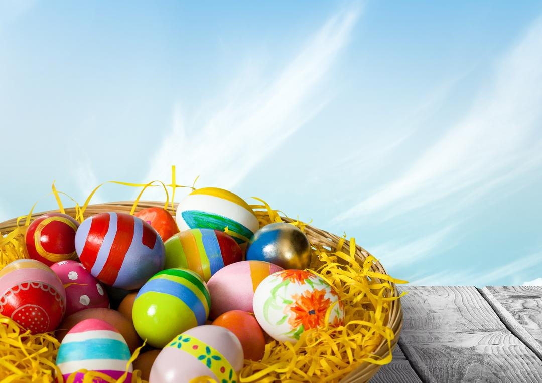 Digital composite of Easter eggs basket in front of blue sky Free Stock Images from PikWizard