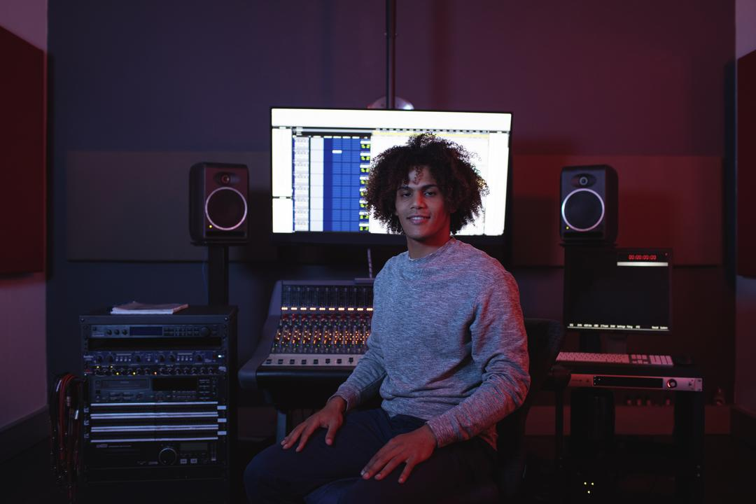 Portrait of male audio engineer sitting in recording studio