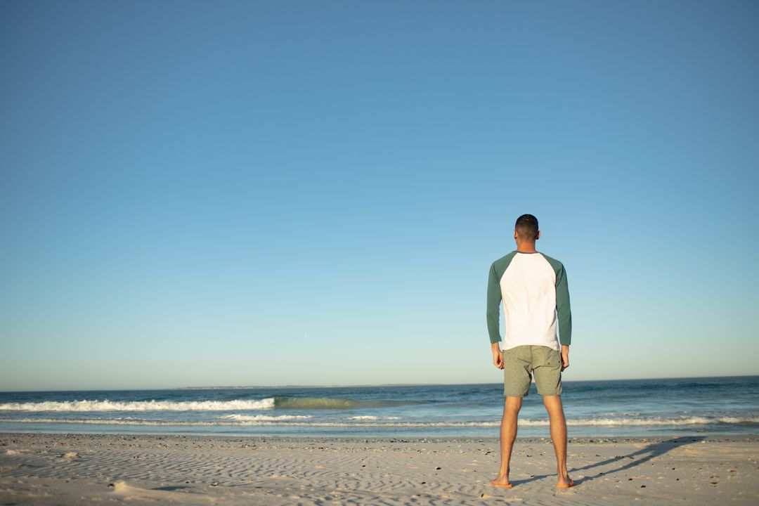 Rear view of man standing on the beach