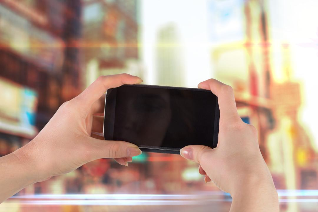 Composite image of hands holding smartphone for a picture Free Stock Images from PikWizard