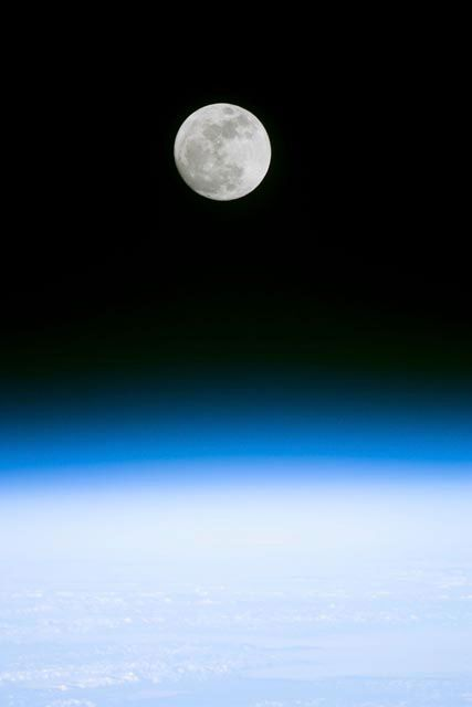 Full moon as seen from STS-103 orbiter Discovery.