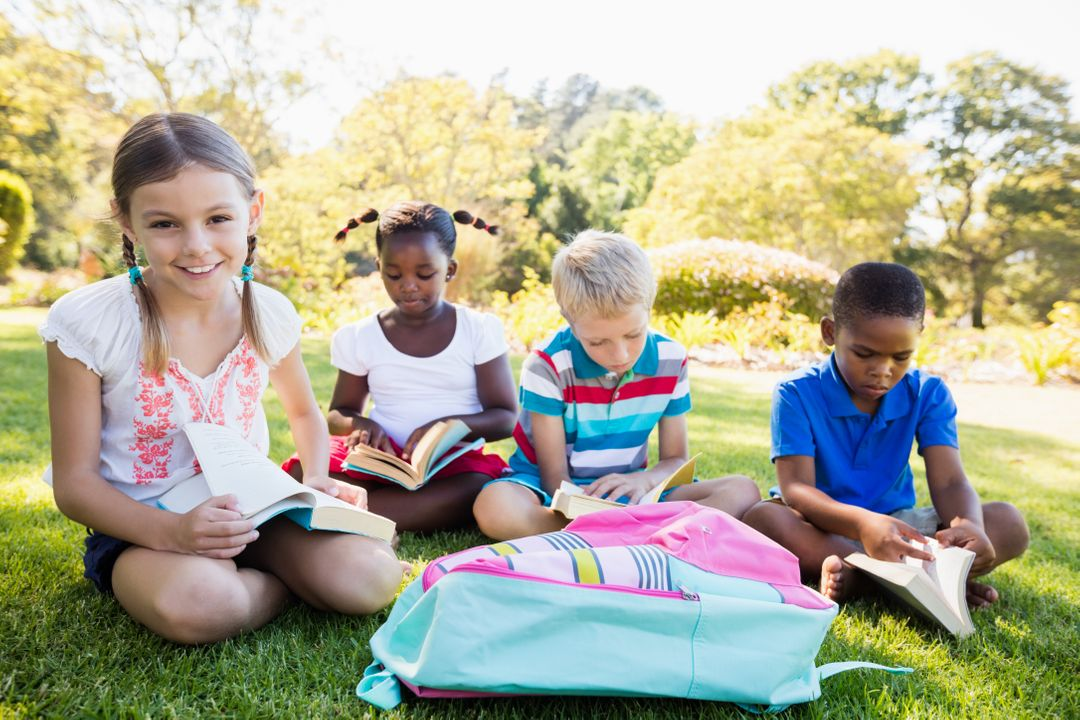 Kids reading books during a sunny day at park  Free Stock Images from PikWizard