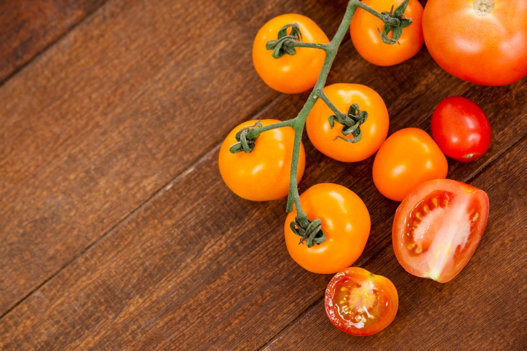 Close-up of various types of tomatoes on wooden table Free Stock Images from PikWizard