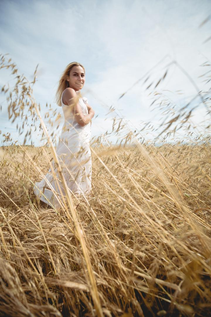 Carefree blonde woman standing in field Free Stock Images from PikWizard