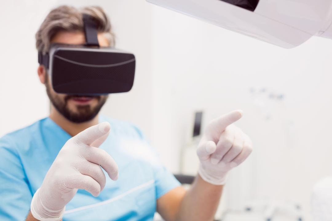 Dentist using virtual reality headset in dental clinic