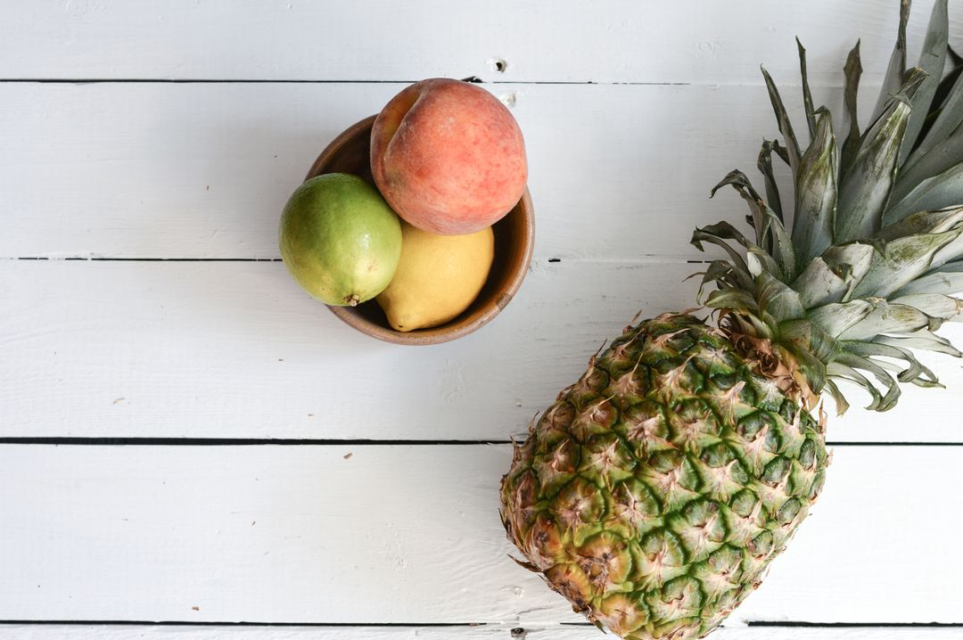 Image of a Pineapple and Other Fruits on a Wooden Table