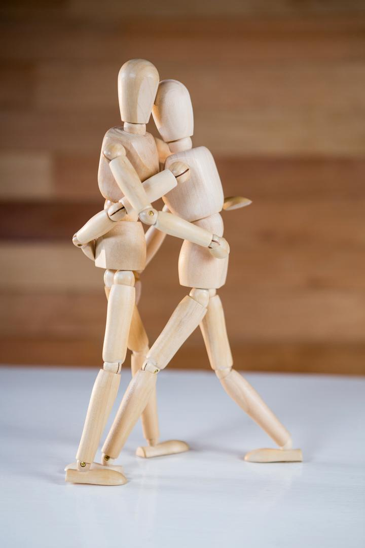 Figurine couple embracing each other