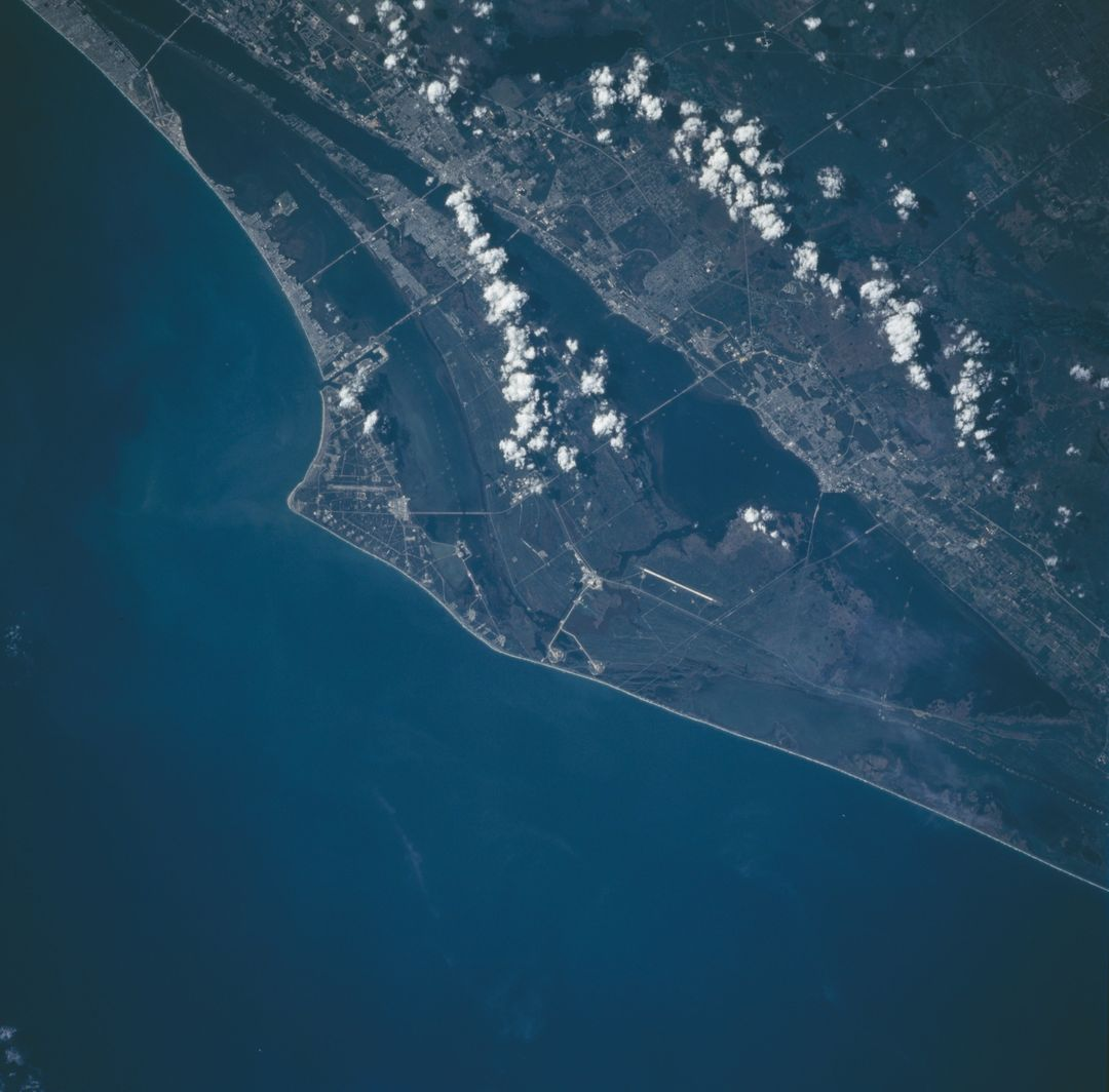 This nadir photograph of the Cape Canaveral area on Florida's eastern coast was taken by the STS-66 crew in November, 1994. The Space Shuttle Vehicle Assembly area and the runways used by the returning Shuttles can be seen near the center of this photograph as part of the John F. Kennedy Space Center (KSC). Launch Pads A and B as well as many other launch pads and a runway can be seen on Cape Canaveral. Cape Canaveral is located to the east of KSC. South of the launch area is Port Canaveral and Cocoa Beach on the Atlantic coast with the towns of Cocoa, Merrit Island and Titusville situated along the Intercoastal Waterway.