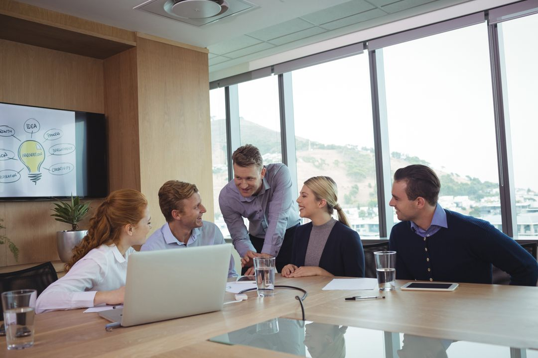 Image of a Group of Five People Discussing Something in a Meeting