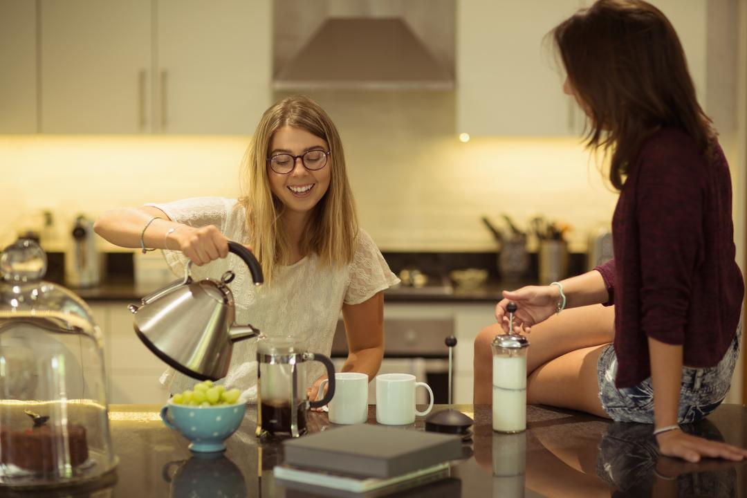 Friends preparing coffee at home