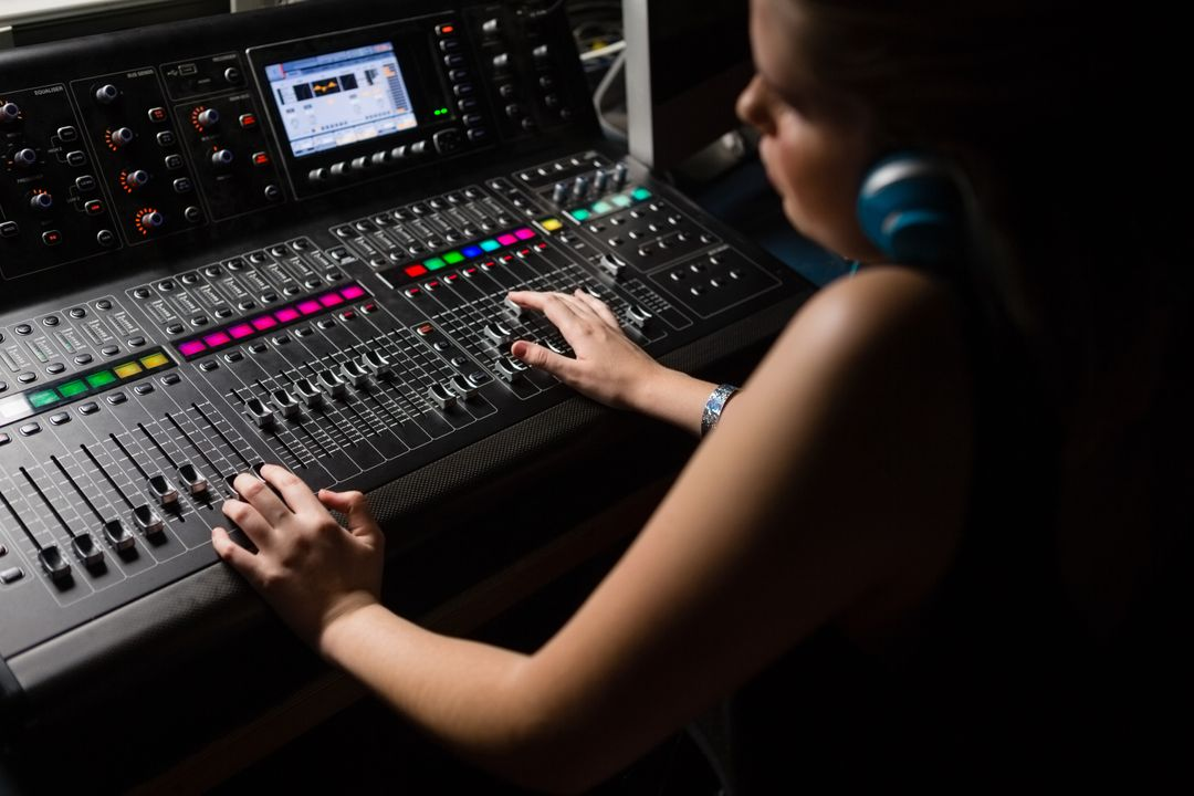 Female audio engineer using sound mixer in recording studio Free Stock Images from PikWizard