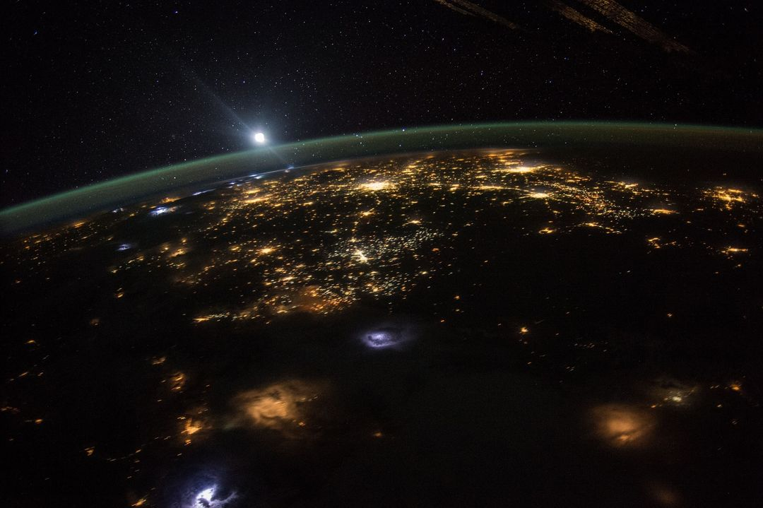 overhead space image of earth cities at night