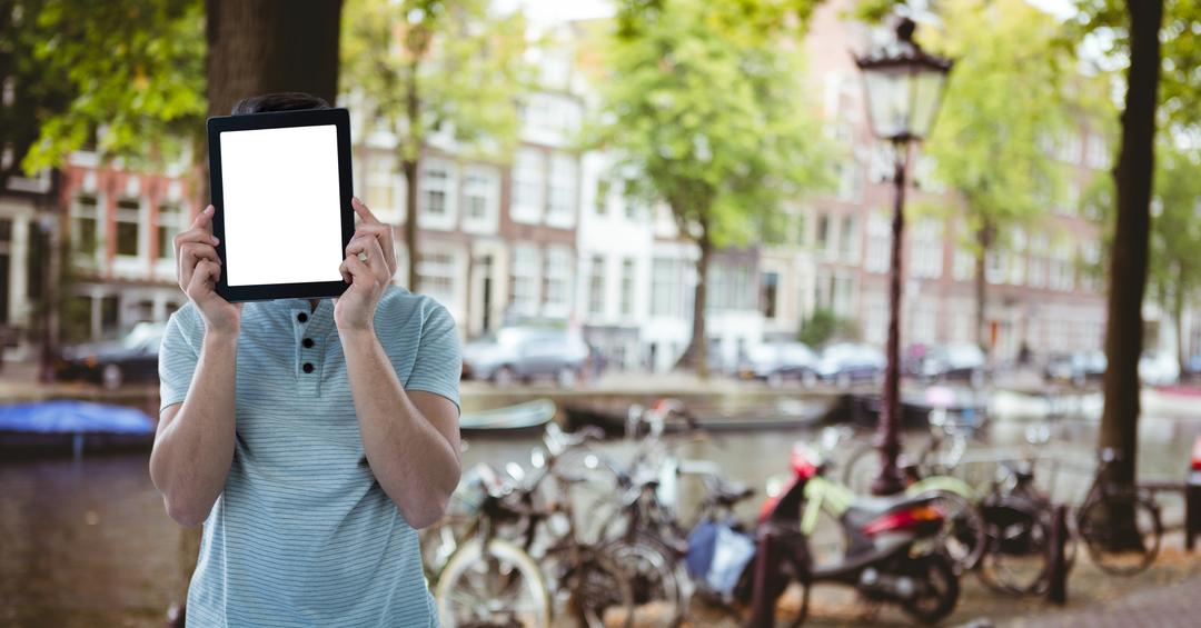 Digital composite of young men with the tablet on his face in the city Free Stock Images from PikWizard