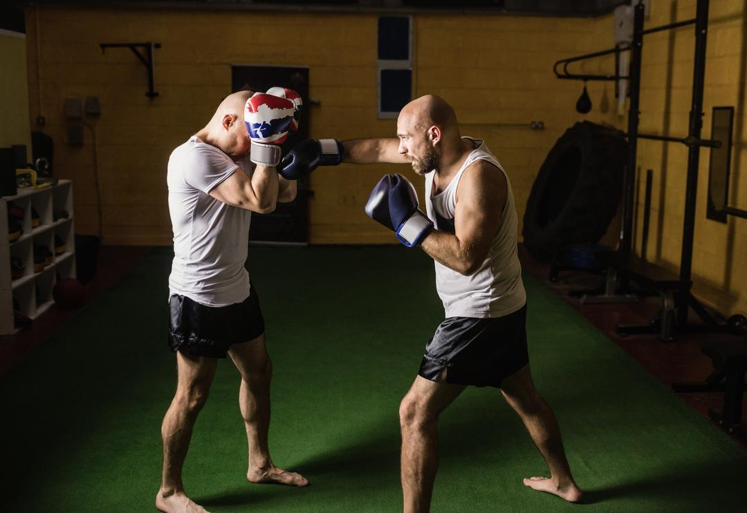 Two thai boxer practicing boxing in fitness studio