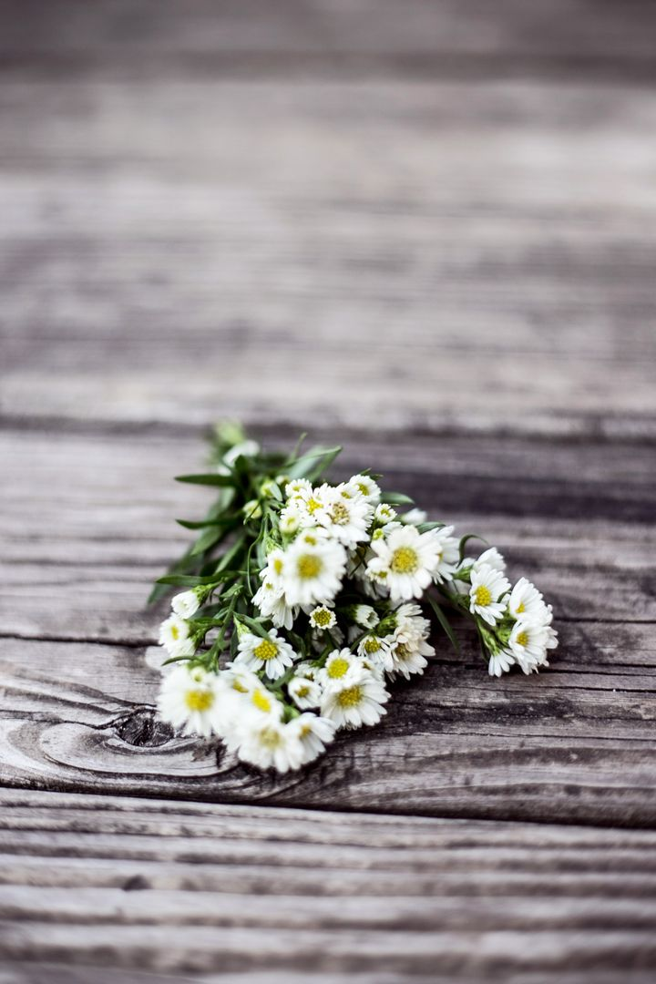 White Petal Flower Bouquet on Brown Wooden Surface