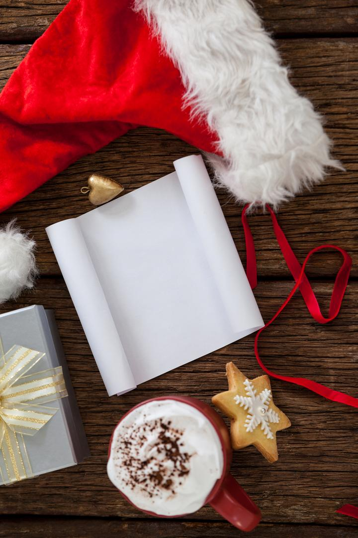 Blank paper with santa hat on a plank