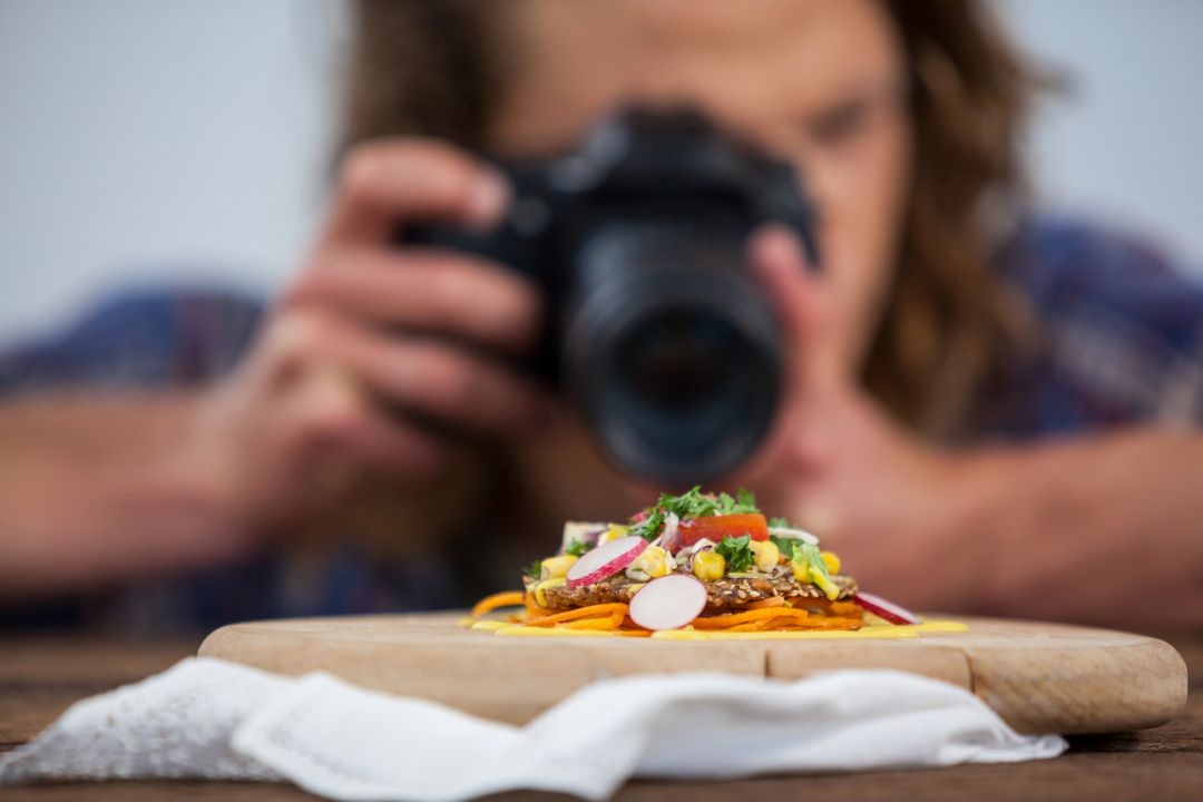 Youtuber using camera to take video of food