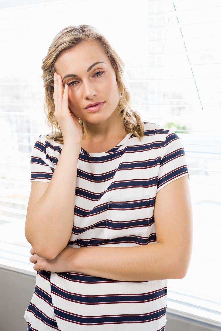 Depressed woman in deep thought at home