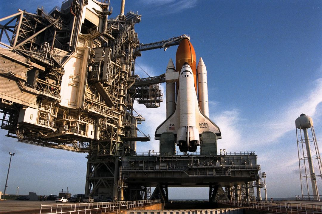 With the Rotating Service Structure rolled back, at left, the Space Shuttle Atlantis undergoes final prelaunch preparations at Launch Pad 39A for the STS-86 mission. One of the final steps will be to load the external tank with approximately 500,000 gallons of liquid hydrogen and liquid oxygen for fueling the orbiter's three main engines. STS-86 is slated to be the seventh docking of the Space Shuttle with the Russian Space Station Mir. Liftoff is targeted for Sept. 25 at 10:34 p.m. EDT during a preferred launch window which lasts six minutes and 45 seconds. Seven crew members will lift off for the scheduled 10-day flight. One of those crew members, David A. Wolf, will transfer to the Mir for an approximate four-month stay. He will replace U.S. astronaut C. Michael Foale, who will return to Earth with the remainder of the STS86 crew. Foale has been on the Russian space station since mid-May
