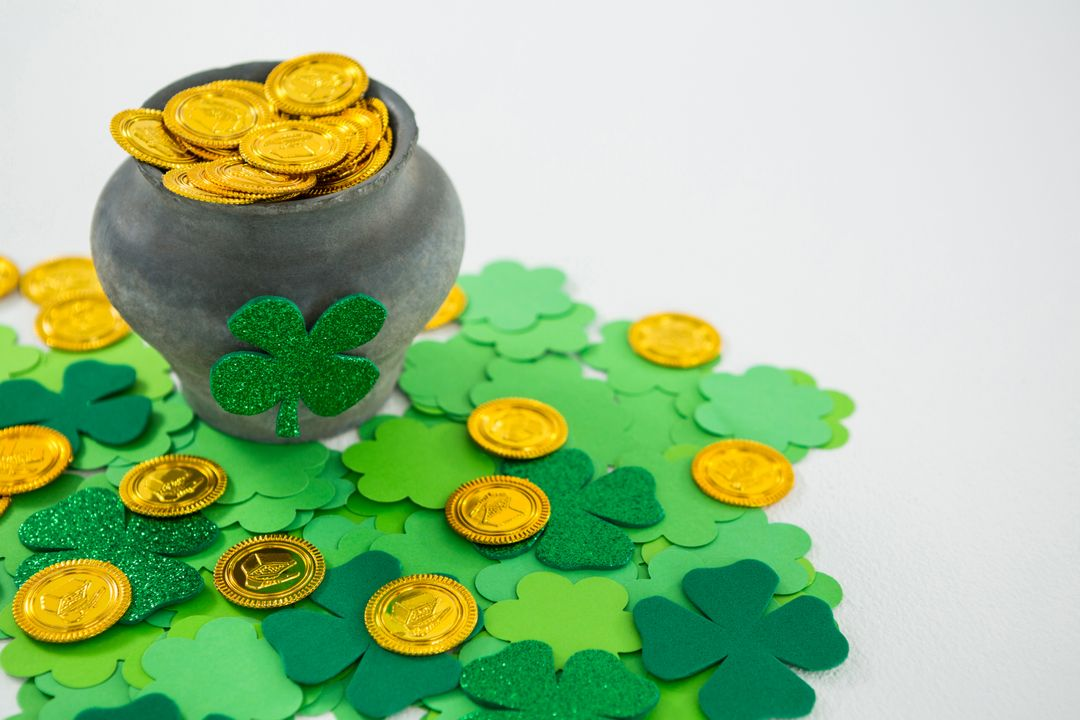 St. Patricks Day shamrock and pot filled with chocolate gold coins on white background Free Stock Images from PikWizard