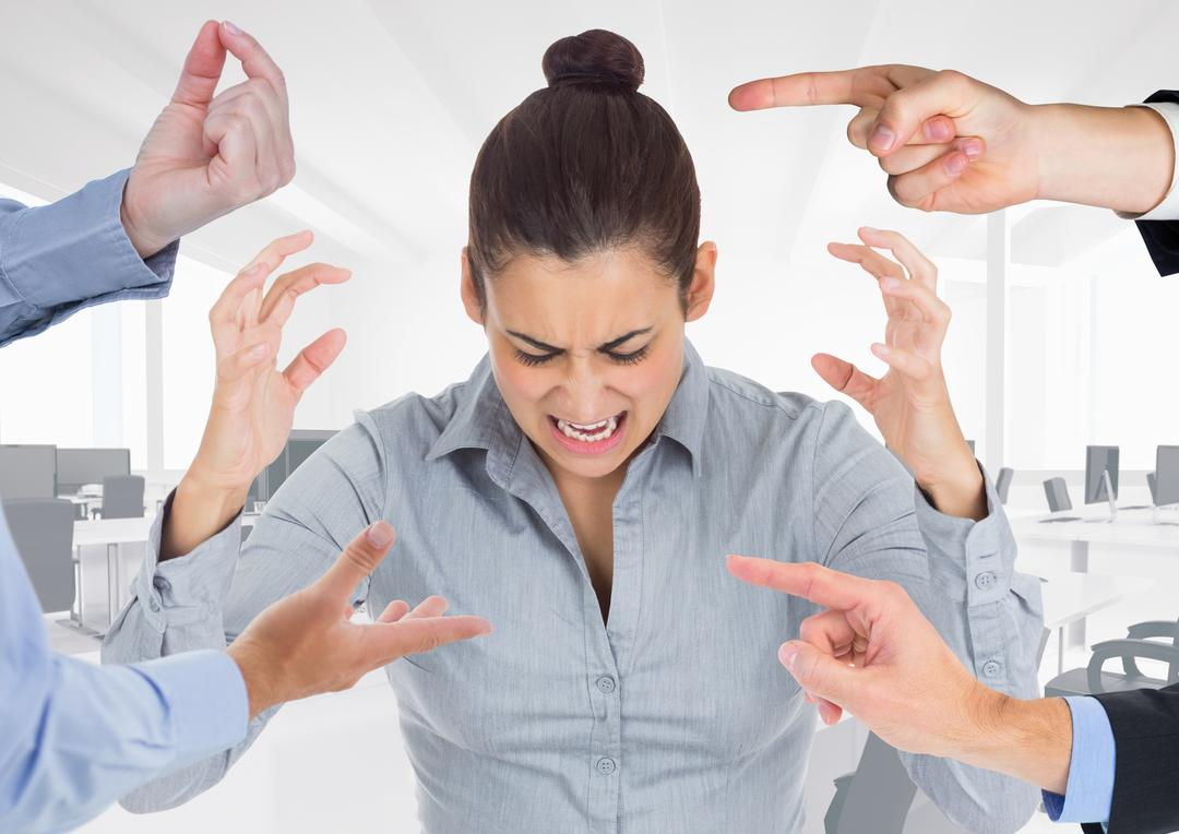 Hands blaming a stressed woman in office
