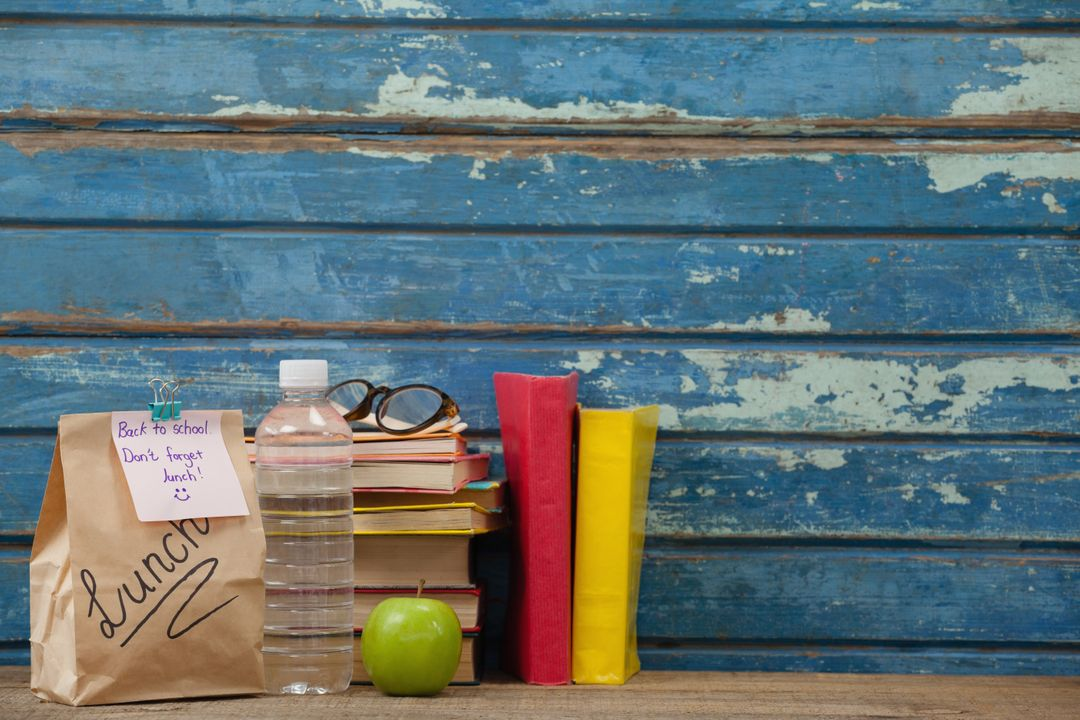 Image of a Blue Grunge Background with School Supplies