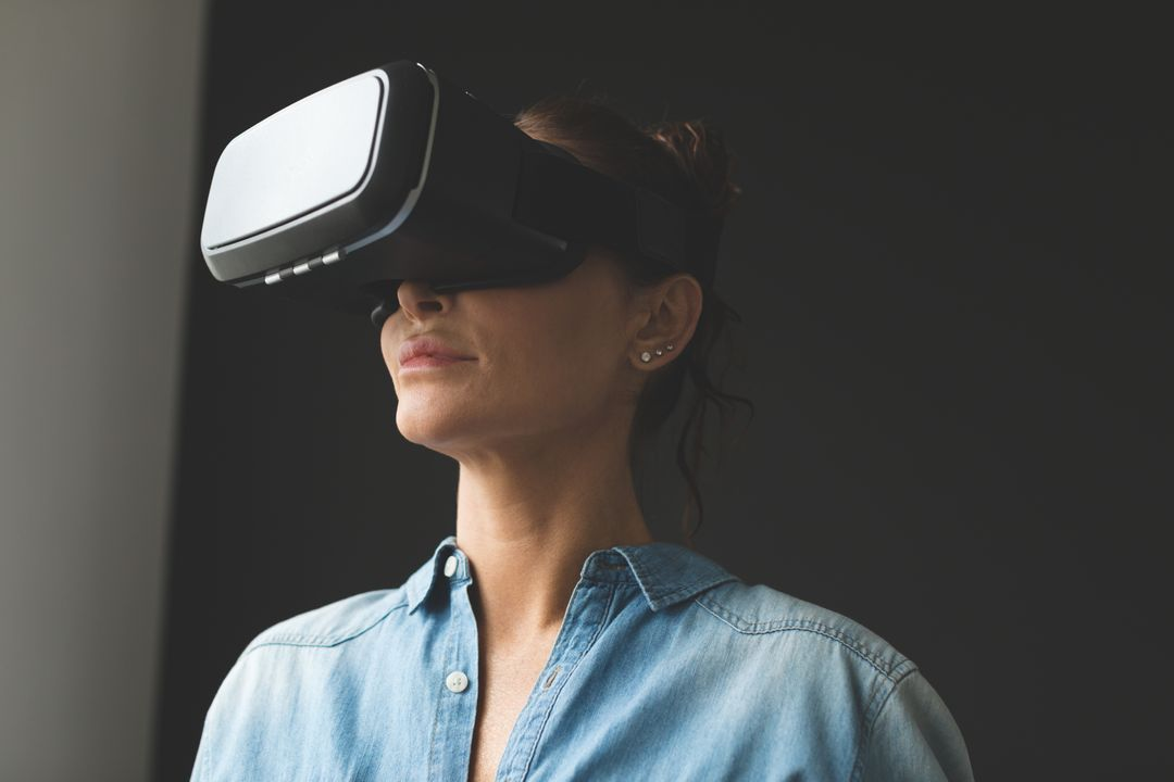 Beautiful woman using virtual reality headset in a comfortable home Free Stock Images from PikWizard