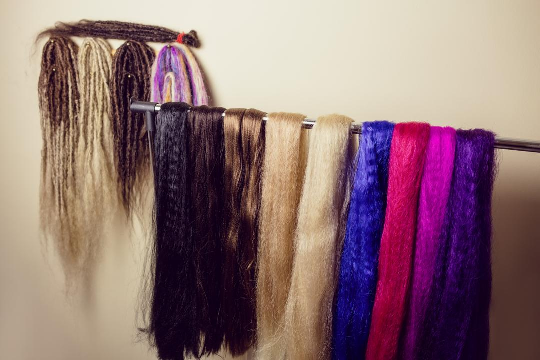 Close-up of artificial dreadlocks materials hanging in shop