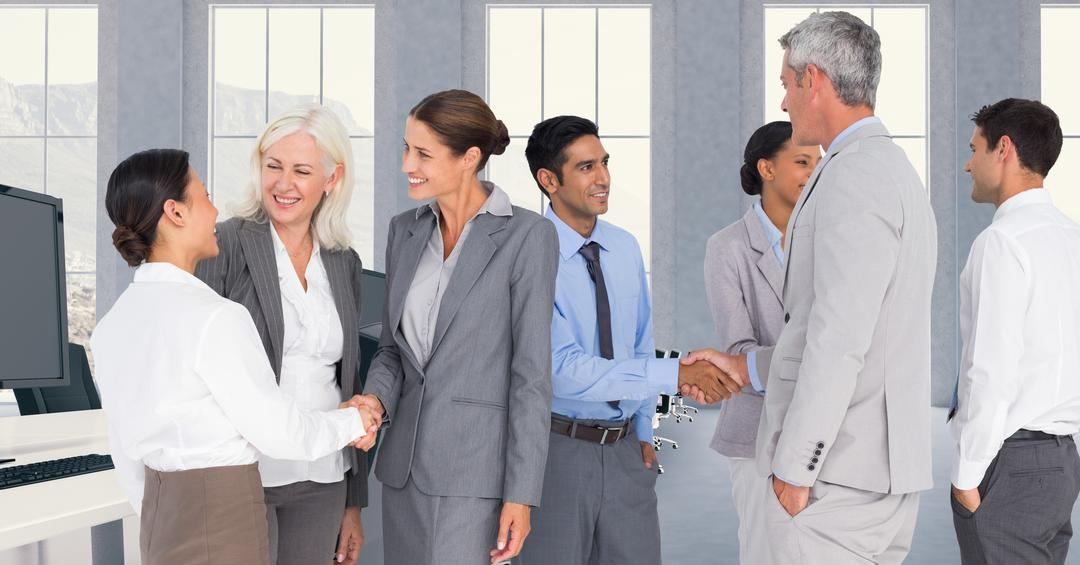 Business executives shaking hands during meeting in office Free Stock Images from PikWizard